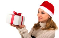 Attractive young girl with Christmas present Royalty Free Stock Image