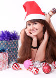 Attractive young girl with christmas presents Royalty Free Stock Images