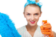 Attractive young girl is cleaning her house Royalty Free Stock Photography