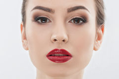 Attractive young girl with cosmetic on face Royalty Free Stock Images