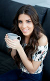 Attractive young girl drinking tea Royalty Free Stock Image