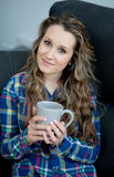 Attractive young girl drinking tea Royalty Free Stock Images