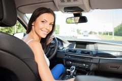Attractive young girl is driving her vehicle Royalty Free Stock Photos