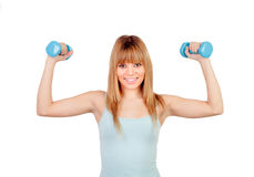 Attractive young girl with dumbbells royalty free stock image