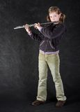 Attractive young girl flautist. stock photo