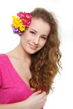 Attractive young girl with flowers Stock Images