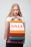Attractive young girl is frustrated after shopping Royalty Free Stock Image