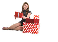 Attractive young girl with gift boxes Stock Photography