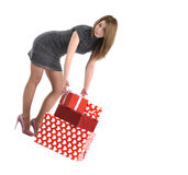 Attractive young girl with gift boxes Stock Images
