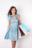 Attractive young girl is going shopping with fun Royalty Free Stock Photography