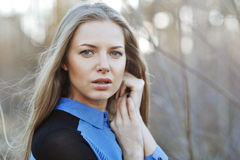 Attractive young girl with hands cupped. Outdoors Royalty Free Stock Photography