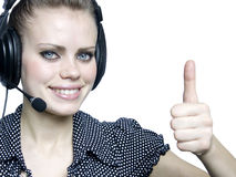 Attractive young girl  with a headset. Beautiful smiling attractive young girl  with a headset Royalty Free Stock Photo