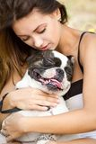 Attractive Young Girl Holding Her Bulldog Royalty Free Stock Images