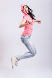 Attractive young girl jumping Stock Photos