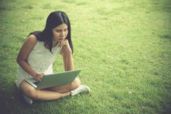 Attractive young girl with laptop outdoors. Beautiful woman work stock image