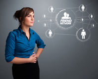 Attractive girl looking at modern social network Royalty Free Stock Photography