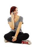Attractive young girl making a phone call. On white background Royalty Free Stock Photo