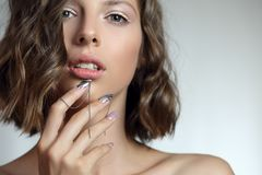 Attractive young girl with NailArt . royalty free stock photography