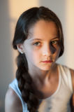 Attractive young girl with a pigtail. Portrait of an attractive young girl with a pigtail Royalty Free Stock Photos