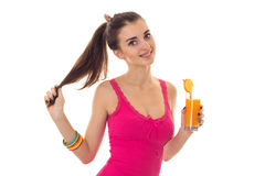 Attractive young girl in pink shirt drink orange cocktail and smiling isolated on white background Stock Images