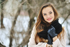 Attractive young girl portrait in a winter park - closeup Royalty Free Stock Photos