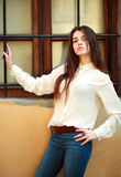 Attractive young girl posing on a city street Stock Photography