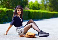 Attractive young girl posing on the street Stock Photography