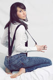 Attractive young girl posing with suspenders Stock Photography