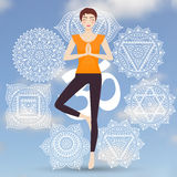 Attractive young girl practicing tree yoga pose Royalty Free Stock Photo