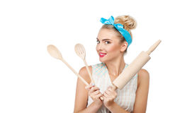 Attractive young girl is preparing to cook Royalty Free Stock Photography