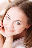 Attractive, young girl proping her bed. Stock Photos