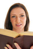 Attractive young girl reading book Royalty Free Stock Images