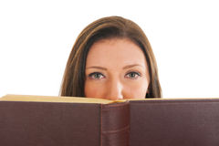 Attractive young girl reading book Royalty Free Stock Photography