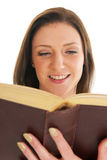 Attractive young girl reading book Stock Image