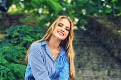 Attractive young girl resting in the city Park stock image