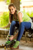Attractive young girl with rollerblades Stock Photos
