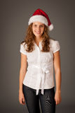 Attractive  young girl in Santa Hat Stock Photography