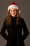 Attractive  young girl in Santa Hat Royalty Free Stock Photos