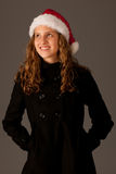 Attractive  young girl in Santa Hat Stock Photos