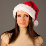 Attractive  young girl in Santa Hat Royalty Free Stock Photography