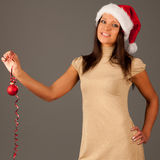 Attractive  young girl in Santa Hat Stock Images