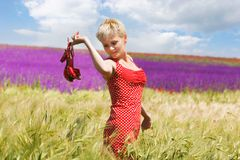 Attractive young girl with shoes in hands Royalty Free Stock Images