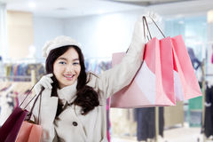 Attractive young girl in the shopping center Stock Photo