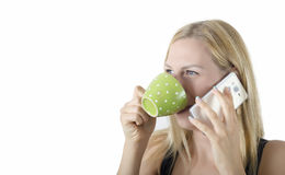 Attractive young girl with smart phone and cup of caffe Stock Image