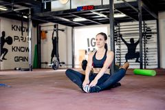 Attractive girl is taking brake after training Royalty Free Stock Image