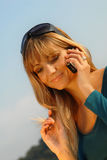 Attractive young girl talking on the mobile phone Stock Image