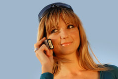 Attractive young girl talking on the mobile phone Royalty Free Stock Images