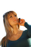 Attractive young girl talking on the mobile phone Stock Photos