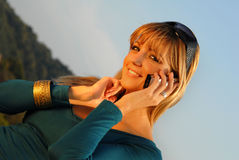 Attractive young girl talking on the mobile phone Stock Photo