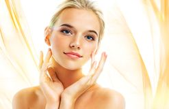 Attractive young girl touching her face royalty free stock images